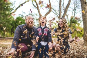 family-playing-with-leaves